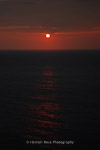 Blood red sunset off Lundy Island, England.